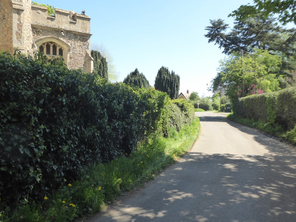 View of The Street round the church towards Upsher Green